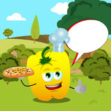 Chef yellow bell pepper with pizza showing thumb up on a meadow with speech bubble Stock Image