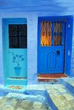 Chefchaouen, Morocco, Africa; 14 October 2018: Two beautifully decorated blue doors in the medina of the famous `blue` town in the royalty free stock images