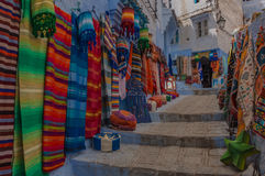 Chefchaouen Streets. A picture of a street in Chefchaouen (Morocco) decorated with local handmade colorful products from vendors stock images