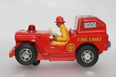 Chefe dos bombeiros do carro do brinquedo com sideview do excitador Imagem de Stock Royalty Free