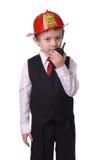 Chefe dos bombeiros do menino Fotografia de Stock Royalty Free