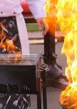 Chefe, grades e flama Imagem de Stock