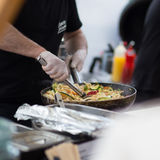 Cheff cooking on outdoor street food festival. Royalty Free Stock Photos