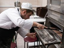 Italian pizza cooking oven baking Royalty Free Stock Images