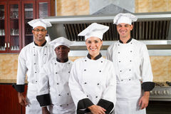 Chefs. Group of professional chefs in commercial kitchen Stock Image