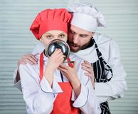 Chefs compliment. man and woman chef in restaurant. couple in love with perfect food. Family cooking in kitchen. secret stock image