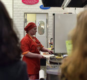 Chefs cook pancakes in front of customers Royalty Free Stock Photos