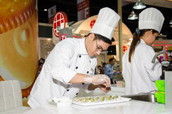 Chefs are cooking demonstrations to visitors in during exhibitio. NONTHABURI - MAY 25 : Chefs are cooking demonstrations to visitors in during exhibition of Stock Images
