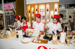 Chefs are cooking demonstrations to visitors in during exhibitio. NONTHABURI - MAY 25 : Chefs are cooking demonstrations to visitors in during exhibition of Stock Image