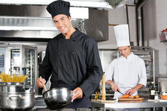 Chefs Cooking Food In Kitchen Stock Photography
