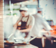 Chefs cooking in the kitchen. Blurred background : Group of chefs cooking in the kitchen Stock Photography