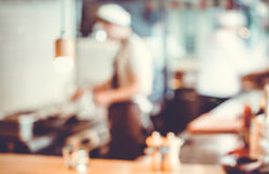 Chefs cooking in the kitchen Stock Photography