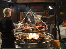 Chefs  cooking various meat on  gill Stock Photography
