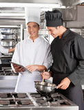 Chefs With Digital Computer Cooking Food Royalty Free Stock Photography