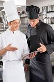 Chefs With Digital Tablet Stock Photography