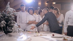 Chefs discuss the dish disposition stock footage