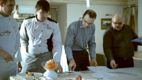 Chefs discuss the dish disposition stock video footage