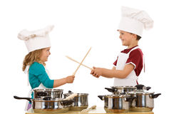 Chefs duel with wooden utensils Royalty Free Stock Photo