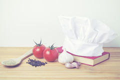 Chefs hat. With cookbook and ingredients Royalty Free Stock Photos
