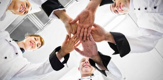 Chefs joining hands in a circle Royalty Free Stock Photography