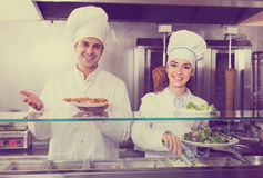 Chefs with kebab and salad at bistro Stock Photography
