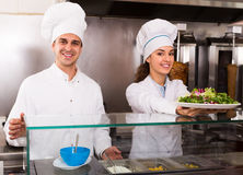 Chefs with kebab and salad at bistro Royalty Free Stock Images