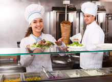 Chefs with kebab and salad at bistro Royalty Free Stock Photo