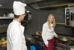 Chefs in a kitchen stock image