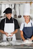 Chefs Kneading Dough In Kitchen Royalty Free Stock Image