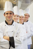 Chefs in line smiling Stock Image