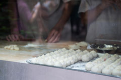 Chefs making baozi. Chefs are showing tourist hwo they make baozi Stock Images
