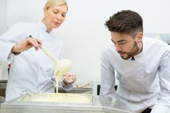 Chefs making whipped egg yolk with sugar royalty free stock photos