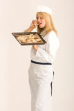 Chefs nibbles at your Christmas cookies Royalty Free Stock Images