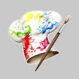 Chefs painted toque hat. Chefs traditional white toque hat with colorful paint splashes next to paintbrush, isolated on gray background Stock Photos