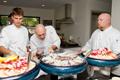 Chefs prepare food for resort grand opening Stock Photos