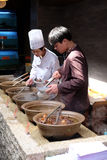 The chefs prepare traditional Chinese food. At the restaurant on the Grand Canal, ancient town of Yuehe in Jiaxing, Zhejiang Province, China Stock Photo
