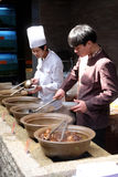 The chefs prepare traditional Chinese food. At the restaurant on the Grand Canal, ancient town of Yuehe in Jiaxing, Zhejiang Province, China Stock Photos