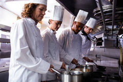 Chefs preparing food in kitchen royalty free stock images