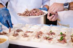 Chefs preparing food for a party Stock Photography