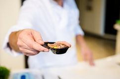 Chefs preparing food for a party Royalty Free Stock Images