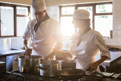 Chefs preparing food at stove Royalty Free Stock Photography