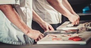 Chefs preparing sushi Stock Image