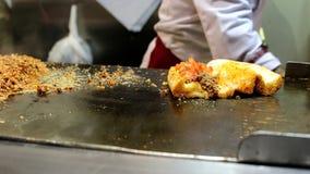 Chefs preparing Turkish Kokorec for service, lamb intestine food sandwich stock video footage