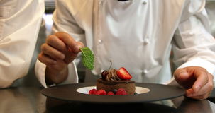 Chefs putting finishing touch on desserts stock video