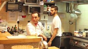 Chefs in the restaurant kitchen stock video footage
