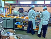 Chefs in restaurant kitchen. Chefs preparing noodles in a commercial kitchen in a hotel restaurant in M Hotel, Singapore stock photography