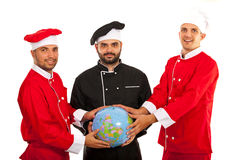 Chefs team holding world globe Stock Photography