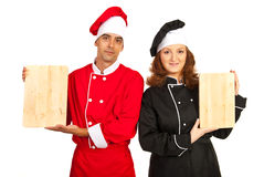 Chefs team showing boards Royalty Free Stock Image