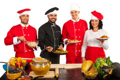 Chefs team shwoing food Royalty Free Stock Photo