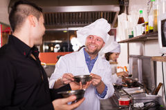 Chefs and waiter working Royalty Free Stock Photography
